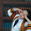 Stock Photo: Asithai attractive Graduate female student in library headach