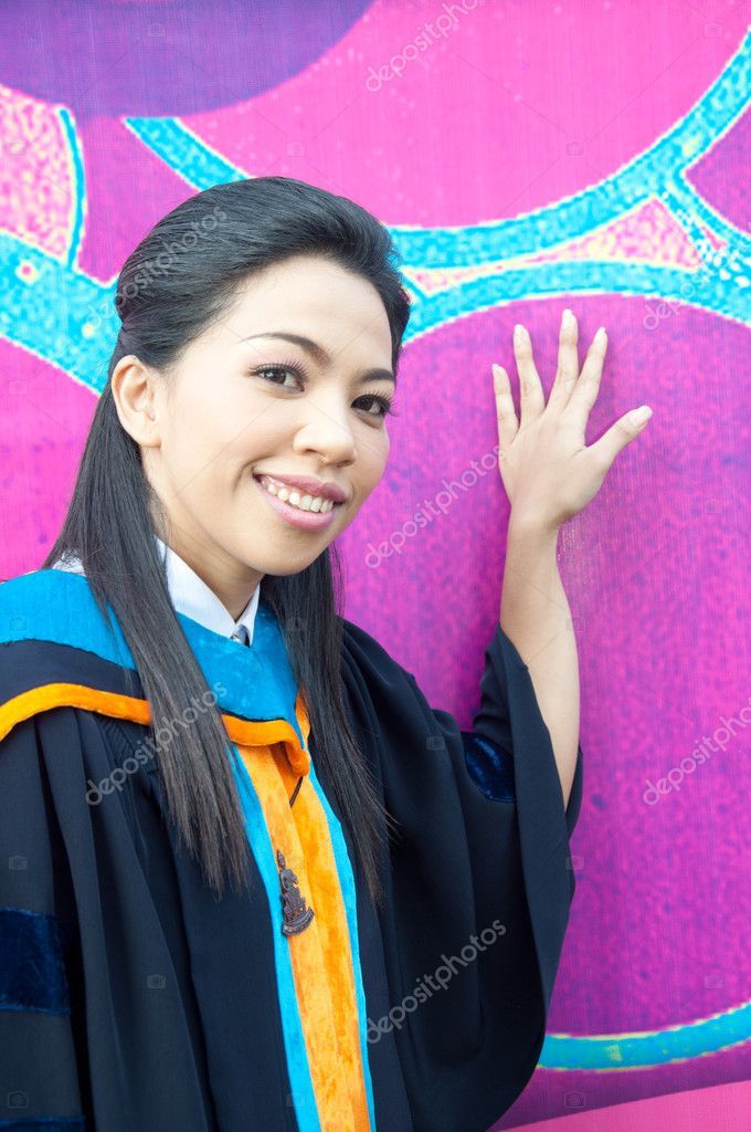 Smiling asian attractive graduate college student woman in white unifom — Stock Photo #9937582