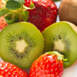Royalty-Free Stock Photo: Kiwi and strawberry on white background