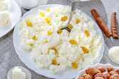 Cottage cheese on a white plate — Stock Photo