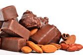 Chocolate candy with peanuts and almonds — Stock Photo