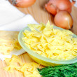 Green dill on the table next to the cheese, onion and pasta — Stock Photo
