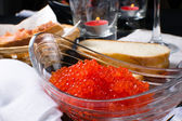 Red caviar in a glass plate — Stock Photo