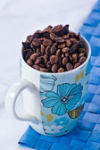 Coffee beans in a blue bowl — Stock Photo