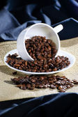 The inverted cup with coffee beans — Stock Photo