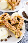 Heart-shaped pastry with sesame seeds — Stock Photo