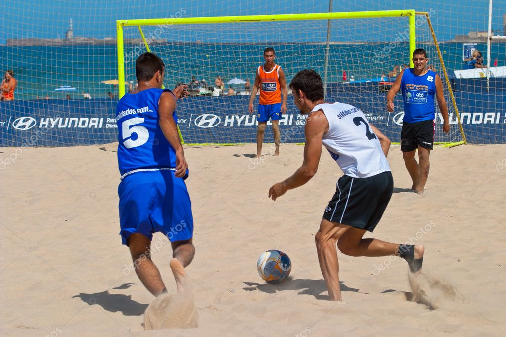 CADIZ, SPAIN -  JUL 22:  Unknown players of unknown team playing the Spanish Championship of Beach Soccer on Jul 22, 2006 on the beach of La Victoria in Cadiz, Spain  Stock Photo #10040703