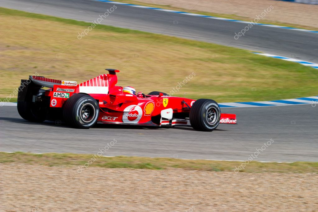 JEREZ DE LA FRONTERA, SPAIN - OCT 10: Marc Gene of Scuderia Ferrari F1 take a curve on training session on October 10 , 2006 in Jerez de la Frontera , Spain  Stock Photo #8061322