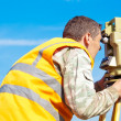 Stock Photo: Surveyor engineer making measuring with theodolite