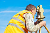Surveyor engineer making measuring with theodolite — Stock Photo