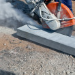 Постер, плакат: Cutting works with petrol driven angle grinder