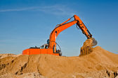 Excavator working at sandpit moving earth — Stock Photo