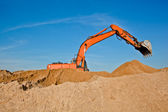 Excavator at sandpit — Stock Photo