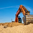 Stock Photo: Excavator at work in sandpit