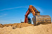 Excavator at work in sandpit — Stock Photo