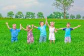 Children at meadow having fun — Stock Photo