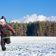 Stock Photo: Running kid in winter