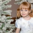 Kid under Christmas tree — Stock Photo
