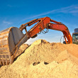 Excavator at sandpit - Stock Photo