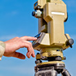 Stock Photo: Entering information into theodolite