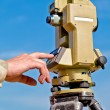 Entering information into theodolite - Stock Photo