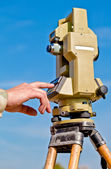 Entering information into theodolite — Stock Photo