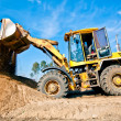 Wheel loader unloading soil at construction site — Стоковая фотография