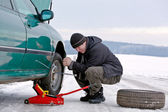 Man driver repairing car at the road — Stock Photo