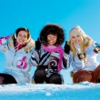 Stock Photo: Three cheerful girls outdoors in winter showing a thumbs up