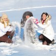 Stock Photo: Pretty girls playing with snow