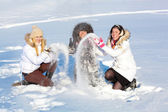 Pretty girls playing with snow — Stock Photo
