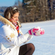 Pretty student girl with snow in palms — Stock Photo