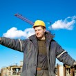 Royalty-Free Stock Photo: Industrial worker gives instructions to construction workers