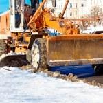 Road scraper removing snow — Stock Photo