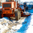 Municipal equipment removing snow from the roads - Stock Photo