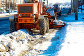 Municipal equipment removing snow from the roads — Stock Photo