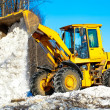 Wheel loader unloading snow during roadworks — Stock Photo