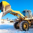 Wheel loader machine unloading snow — Stock Photo
