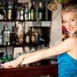Young beautiful blonde woman at a bar counter — Stock Photo