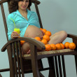 Stock Photo: Girl with oranges