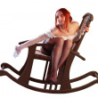 A girl is in an armchair — Stock Photo