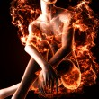 Sexy woman in fire — Stock Photo #10071368