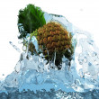 Stock Photo: Pineapple in water