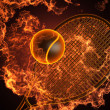Tennis racket in fire — Stock Photo