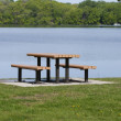 Picnic table by lake — Stock Photo