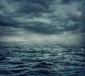 Rain over the stormy sea — Stock Photo