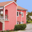 Colorful pink  vacation house — Stock Photo