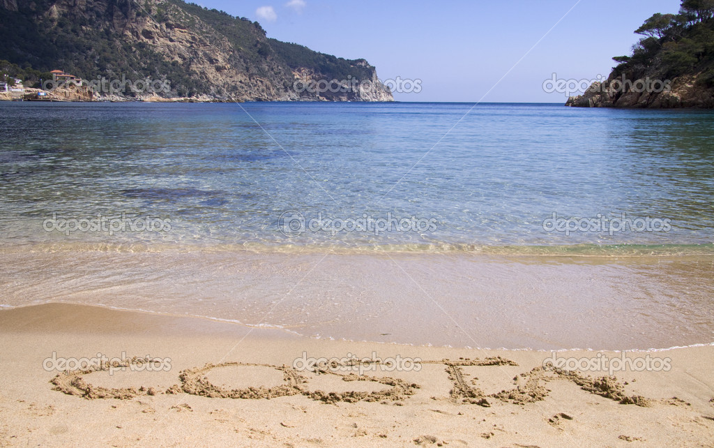 Costa written in sand on a nice beach — Stock Photo #10529033
