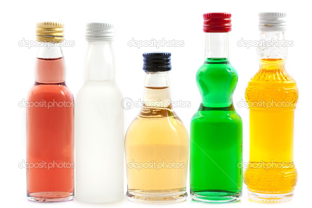 Bottles with liquor in different colors isolated over white  Stock Photo #10529682