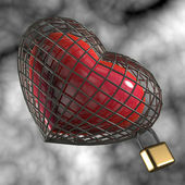 Heart in a cage with a padlock. — Stock Photo